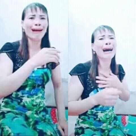 Cô gái áo xanh khóc lóc mặt xấu hoảng sợ