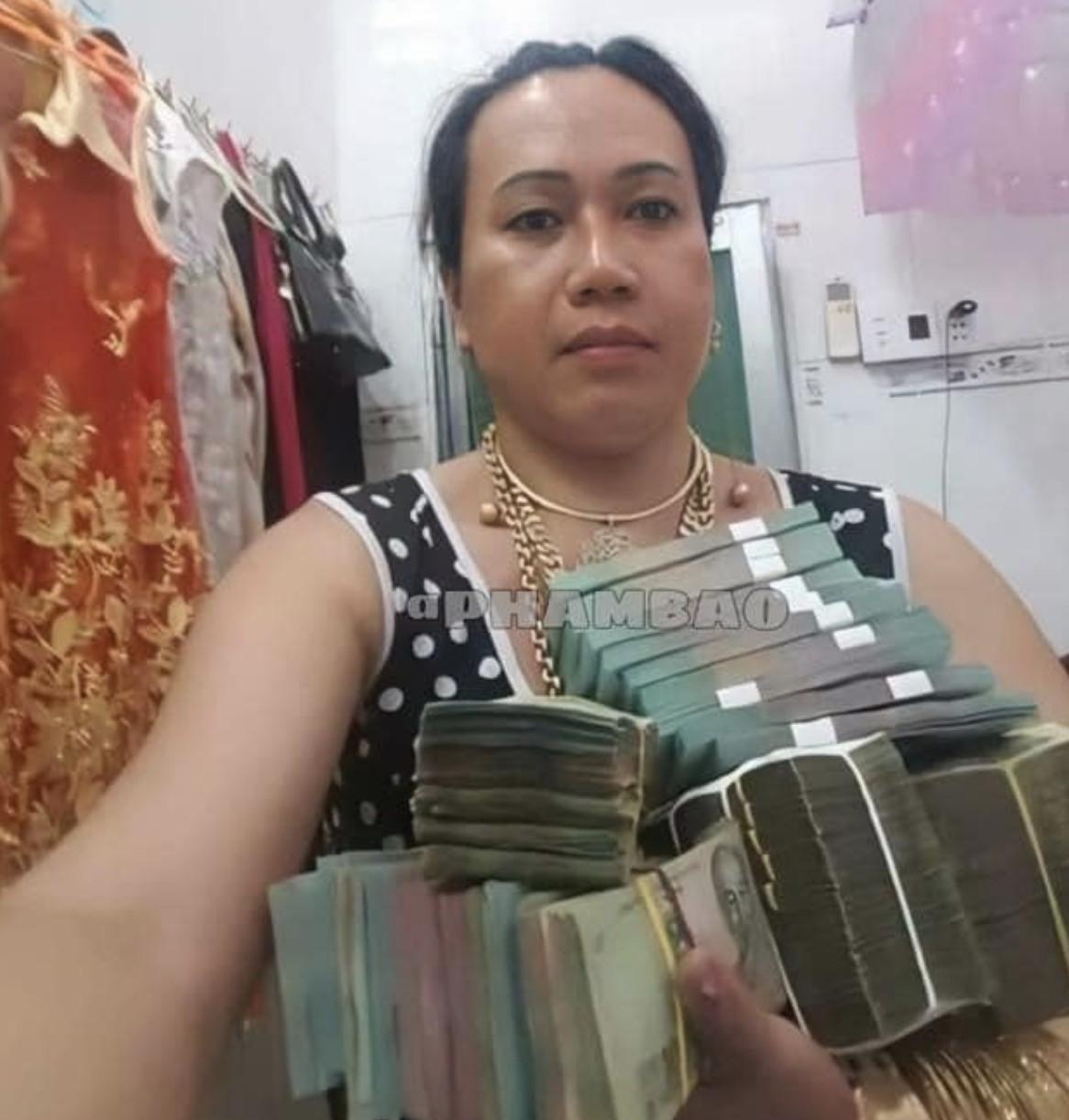 Ảnh meme cô Minh Hiếu khoe tiền nhiều