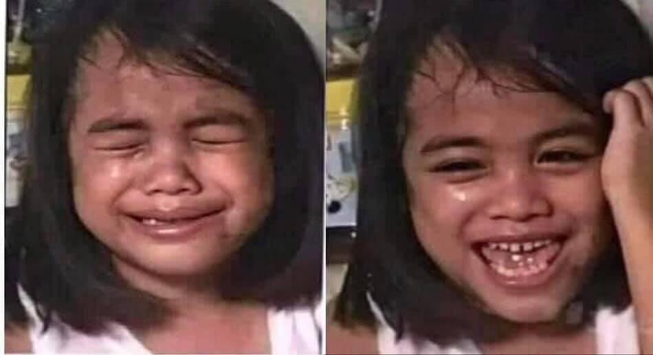 Bé gái đang khóc đột nhiên cười rất tươi