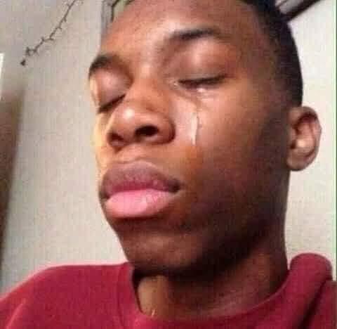 Anh da đen áo đỏ môi dày khóc nước mắt chảy thành dòng