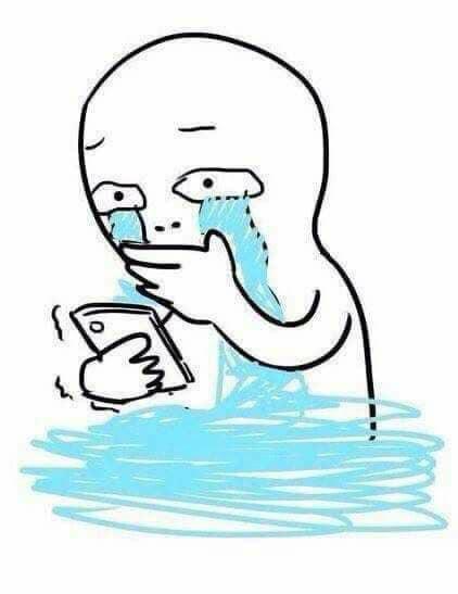 Vừa xem điện thoại vừa ôm mặt khóc nước mắt chảy thành sông